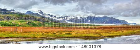 Panorama of Vatnajokull glacier and mountains, South Iceland