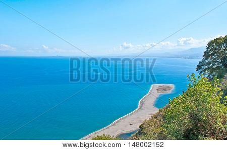 The beautiful seascape with the sandspit that is the part of Laghetti di Marinello Nature Reserve Tindari Sicily Italy.