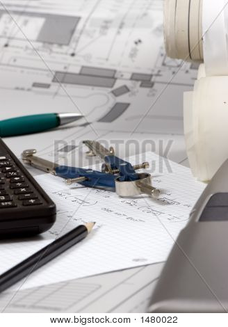 An Engineer calculates the final figures for a design poster