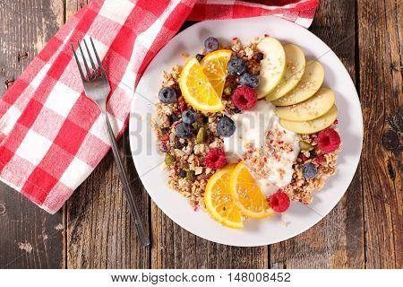 breakfast with muesli,yogurt and fruit