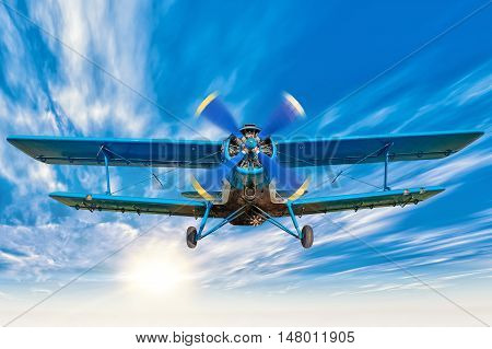 picture of an biplane in a blue sky