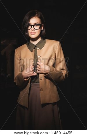 Portrait of fashionable woman in modern interior