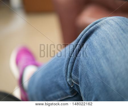 Selective focus at blue jean pant on leg