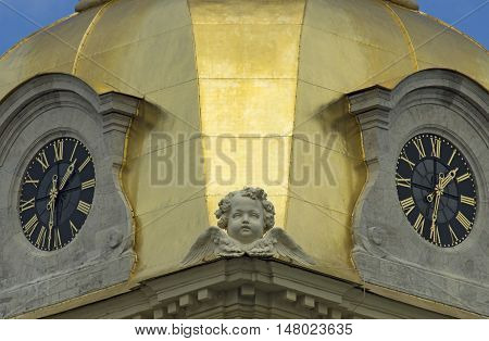 The main hours of the city with the cherub on Peter and Paul Cathedral (St. Petersburg).