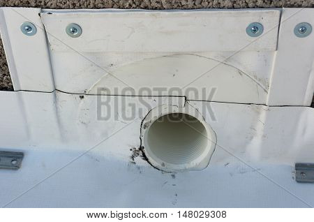 hole for evacuation of rainwater from a balcony waterproofed with PVC sheet