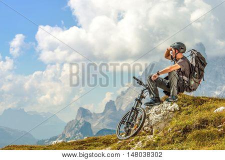Mountain Biker Resting on the Mountain Trail. Biking Theme.