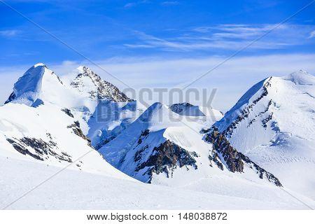 Castor and Pollux, Roccia Nera and slope of Breithorn, above Gorner glacier adjacent Matterhorn, Zermatt, Switzerland