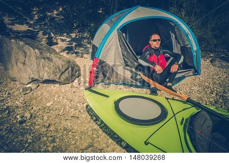 Lake Shore Camping Place. Men Camping on the Lake Shore and Taking Kayak Trips. Outdoor Lifestyle.