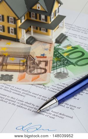 Model House on Money and Lease Agreement Document