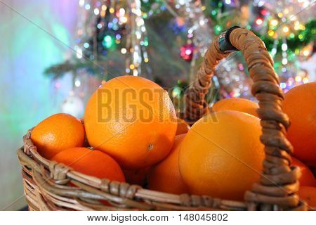 basket of oranges on the background of the Christmas tree. The smell of citrus and Xmas trees - the traditions and symbols of the Soviet Union and Russia