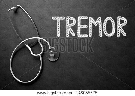 Medical Concept: Tremor Handwritten on Black Chalkboard. Top View of White Stethoscope on Chalkboard. Medical Concept: Tremor on Black Chalkboard. 3D Rendering.