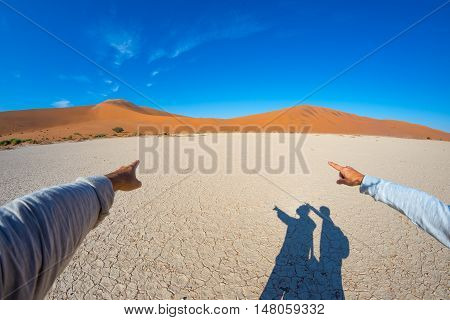 Fingers Pointing To The Scenic Sand Dunes Of Sossusvlei, Namib Naukluft National Park, Namibia, Afri