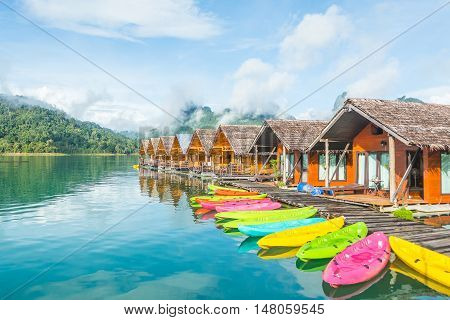 Resort on water with colorful kayaks in Ratchaprapha dam Surat Thani Thailand.