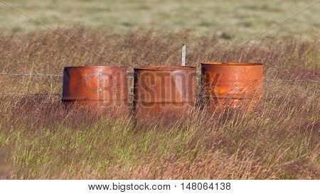 Old steel drums in a field in Iceland