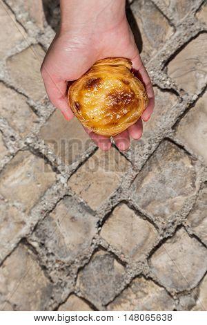 Portuguese Dessert Pasteis De Nata In Women Hand