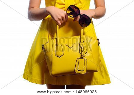 Elegant Fashionable Woman In Yellow Dress With Handbag And Sunglasses