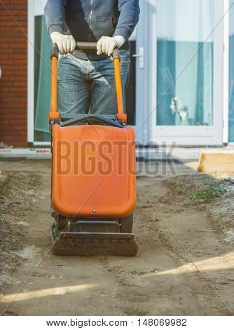 Vibratory plate compactor to make the soil flat before paving