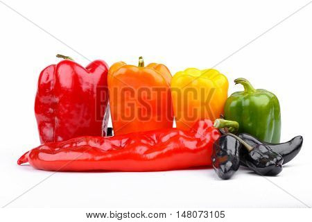 varicoloured bell peppers closeup on white background