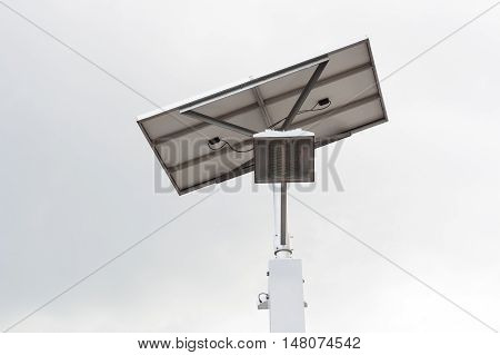 LED light post with solar cell panel with beautiful sky background