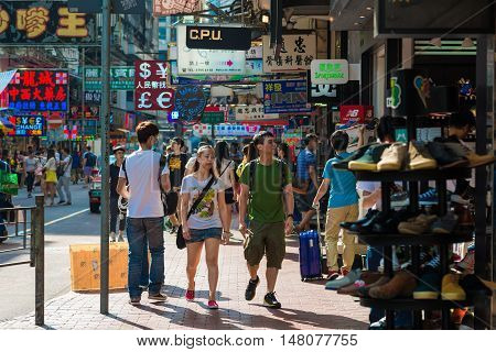 HONG KONG - OCT 24: People shopping at Mong kok on October 24 2015 in Hong Kong. Mong kok is characterized by a mixture of old and new multi-story buildings with shops and restaurants at street level.