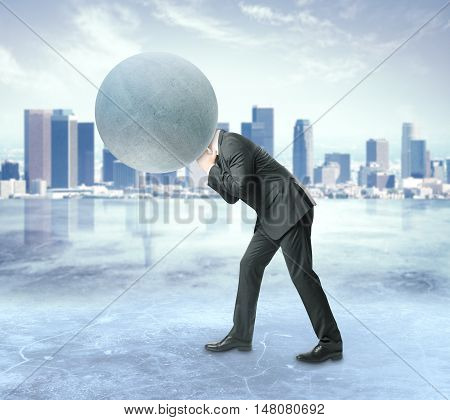 Man with concrete sphere instead of head on city background. Burden concept