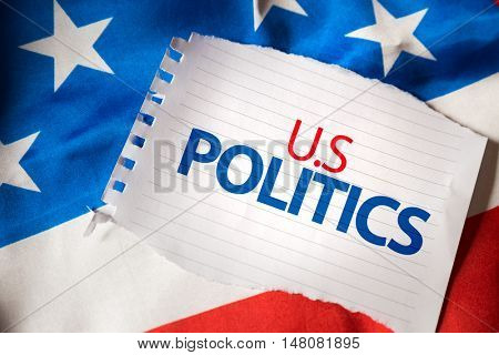 U.S Politics on notepaper and the US flag