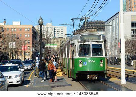 BOSTON - APR 6, 2014: Boston Metro (MBTA) Kinki Sharyo Type 7 Green Line at Boston University in Boston, Massachusetts, USA.