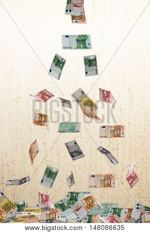 falling of euro currency on the unfocused background