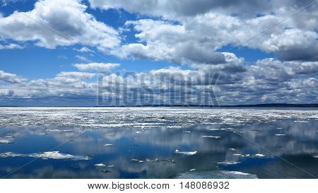View of Lake Superior in the United State at the beginning of the summer. There are still blocks of ice floating on the lake surface. Photo taken from the side of Bayfield, Wisconsin. Natural colors and light.