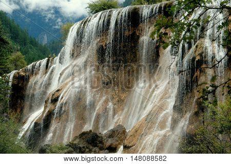 Jiu Zhai Guo / Sichuan China - August 22 2006: Spectacular Pearl Shoal Waterfall at Jiu Zhai Gou National Scenic Park