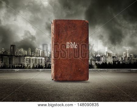 Bible On View Of City In Stormy Sky