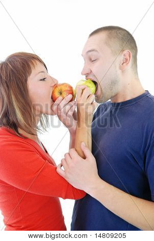 healthy couple with eating apple