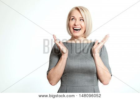 Surprised woman over white background. Human face expression, emotions, feeling attitude reaction. Beautiful woman face close