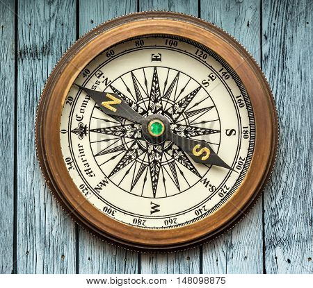 Vintage Compass On Wooden Background