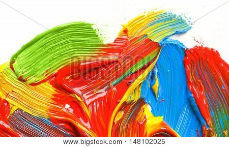Dabs of multi-colored paints on a white background. Wide dabs brush.