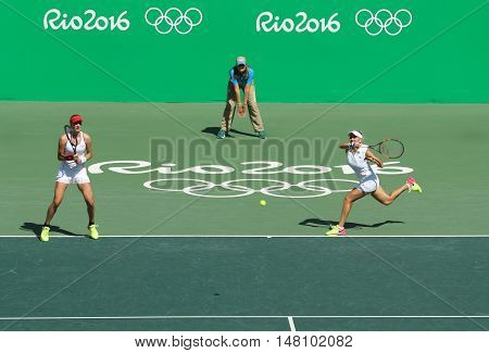 RIO DE JANEIRO, BRAZIL - AUGUST 14, 2016: Ekaterina Makarova (L) and Elena Vesnina of Russia in action during women's doubles final  of the Rio 2016 Olympic Games at the Olympic Tennis Centre
