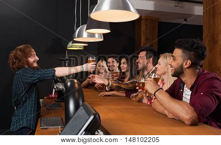 Young People Group In Bar, Barman Give Beer, Friends Sitting At Wooden Counter Pub, Friends Communication Party Celebration
