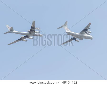 Moscow - May 9 2015 two planes Il-78 and Tu-95 refuel in the air flying in the sky over Red Square on May 9 2015 Moscow Russia
