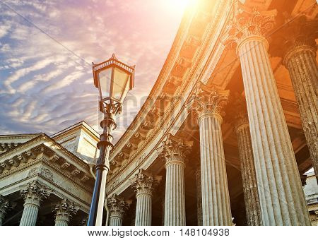 Architecture landmark of St Petersburg, Russia. Architecture details of Kazan Cathedral in St Petersburg, Russia - columns and metal lantern against dramatic sunset sky. Sunset architecture view of St Petersburg, Russia