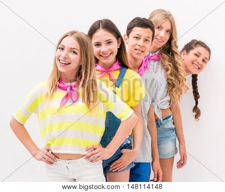 cute teenage children standing one by one on white background