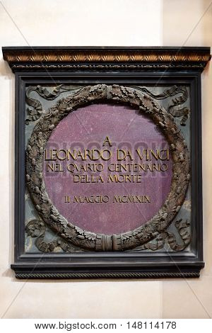 FLORENCE, ITALY: January 19, 2016 : memorial plaque dedicated to the 400 anniversary of the death of Leonardo Da Vinci in Santa Croce basilica on january 19, 2016, Florence, Italy