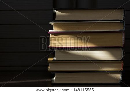 books with hard cover are folded to lie flat on each other