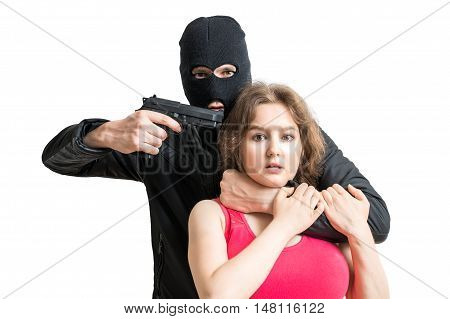 Hostage of terrorist or burglar threatening with gun. Isolated on white background.