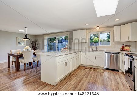 Modern Kitchen Room Interior In White Tones With Hardwood Floor.