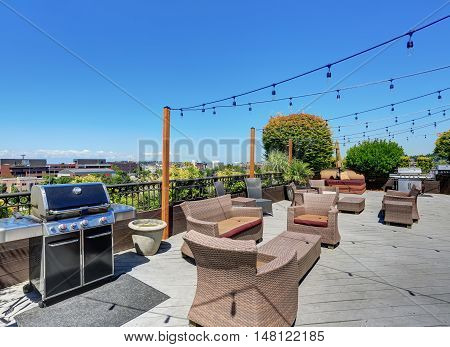 Walkout Deck Of Apartment Building With Many Armchairs