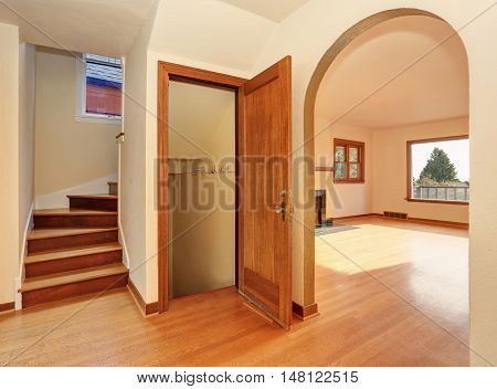 Empty Hallway Interior With Hardwood Floor. View Of Stairs To Second Floor