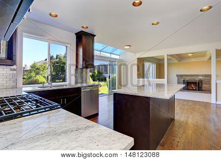 Kitchen Room Interior With Deep Brown Cabinets With Granite Counter Top