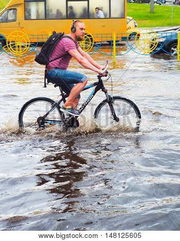Ride Bicycle In The Rain