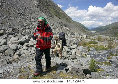 Alpinists traversing Akkem Valley in Altai Mountains, Russian Federation