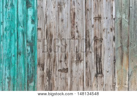 Wooden Palisade background. Close up of grey and green wooden fence panels. Old wooden fence. wood texture background. wood fence background